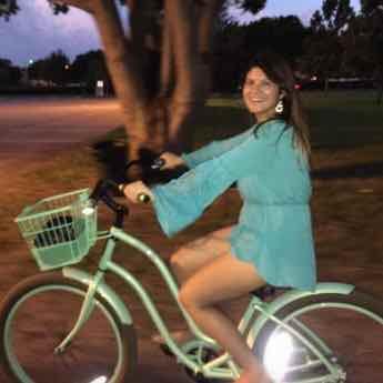 Image of Lindsay on a Bike - Follow Psychic Medium and Mentor @LindsayMarinoMedium on Instagram